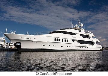 super yacht - large white private mega yacht alongside dock