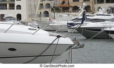 Super yachts moored at Portomaso Marina in St Julian, Malta
