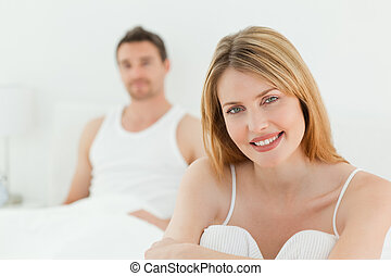 Superb woman looking at the camera with her husband