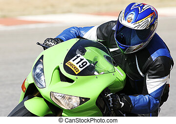 High speed Superbike on the circuit – Kyalami, South Africa – Movement on elements of the image. Trackday (all Logos and Trademarks removed)