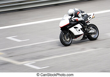 Superbike Race - Superbike racing participant in action.