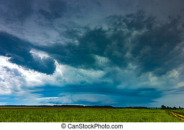 Supercell storm clouds with intense tropic rain