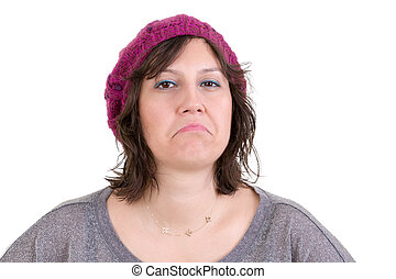 Supercilious disdainful woman in a knitted purple beanie sneering at the camera with a scornful look, head and shoulders on white