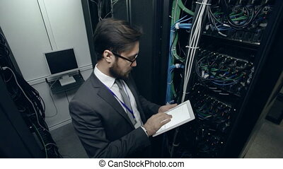 Scientist working at computer project in wire room