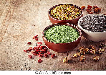 Superfood - Bowls of various superfood on wooden background