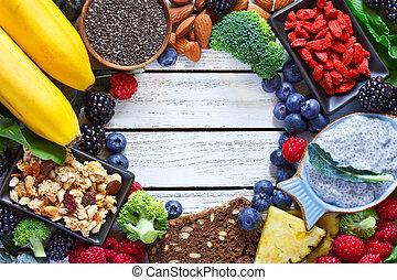 Superfood. Frame of healthy vegan ingredients on white ...