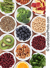 Superfood health food selection in white bowls.