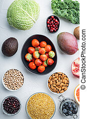 Superfoods dieting concept, top view, on white background
