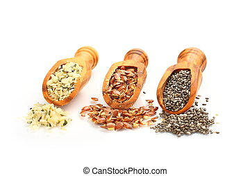 Superfoods in wooden scoops, one of the superfoods (seeds of...