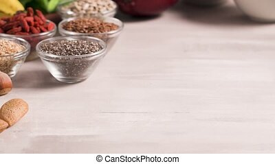 Healthy vegan food - Superfoods on a gray background with...