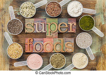 superfoods word in letterpress wood type surrounded by...