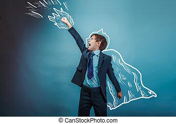 superhero boy raised his hands superpower businessman flying behind a cloak photo studio teenager