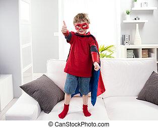 Superhero boy thumb up - Smiling superhero boy standing on...