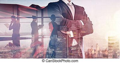 superhero businessman looking at city