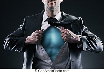 Superhero businessman pulls open shirt. Change and success...