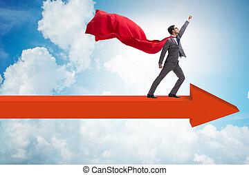 Superhero businessman standing on arrow