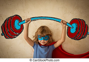 Success - Superhero child against grunge wall background....