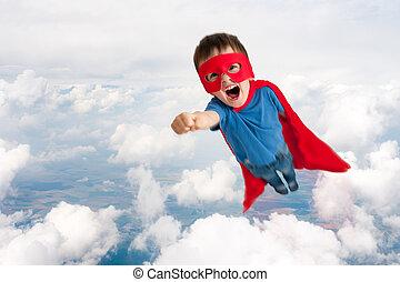 superhero boy child flying upwards through the clouds