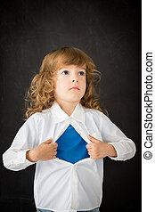 Superhero child in class