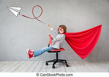 Superhero child playing indoor