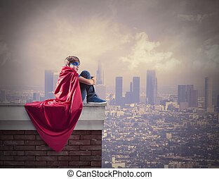 Superhero kid. - Superhero kid sitting on a wall that...