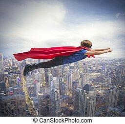 Superhero kid flying fast over the city