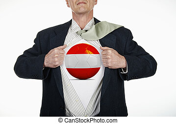 Superhero pulling Open Shirt with soccer ball - Austria