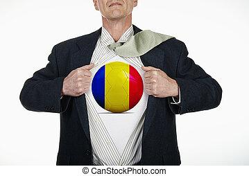 Superhero pulling Open Shirt with soccer ball - Romania