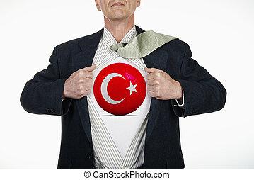 Superhero pulling Open Shirt with soccer ball - Turkey
