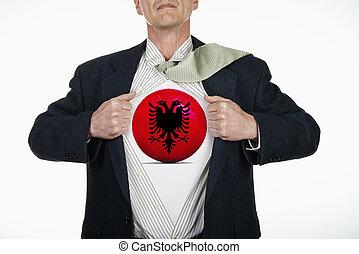 Superhero pulling Open Shirt with soccer ball - Albania