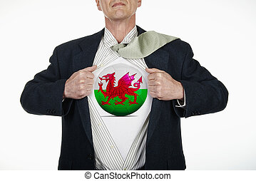 Superhero pulling Open Shirt with soccer ball - Wales