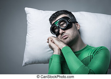 Superhero sleeping on a pillow floating in the air