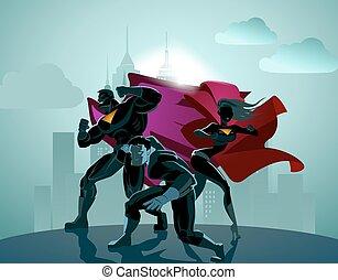 Superhero Team; Team of superheroes, posing in front of a light.