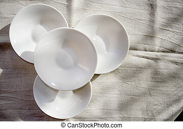 superimposed white small saucer