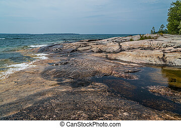 Superior lake - Rocky promontory in Superior Lake Park. ...