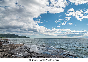 Superior lake - Rocky promontory in Superior Lake under blue...