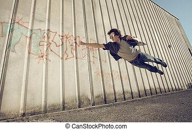 Superman - Young man feels like a superhero, flying free.