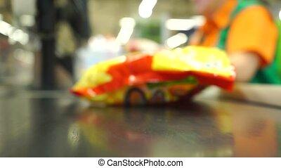 Supermarket checkout shallow focus video clip