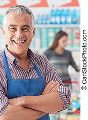Supermarket clerk portrait - Confident smiling supermarket...