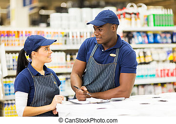 supermarket colleagues talking about stock in store