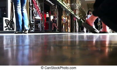 Supermarket customers, floor view, time lapse