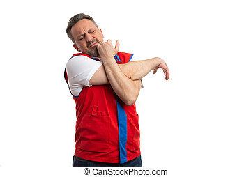 Supermarket employee stretching arm and shoulder