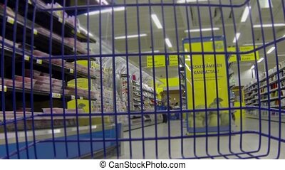 HD1080: shopping cart going around grocery store. Camera in basket. Time Lapse