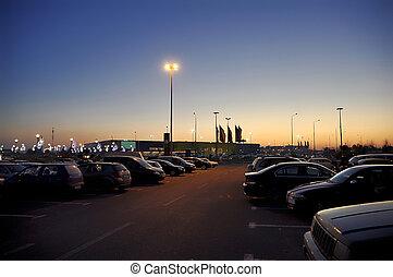 Supermarket parking lot - This photograph represent an ...