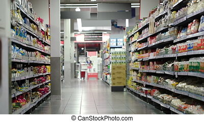 Supermarket section with products - Food section in...