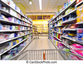 supermarket with chopping cart and aisle in blurred motion
