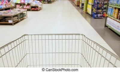 supermarket shopping time lapse shopping trolley. the cart is driving through the supermarket