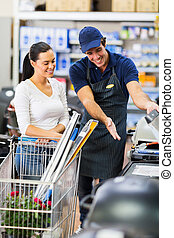 supermarket worker help female customer