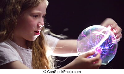 Supernatural Skills - Girl conjuring with magic ball and...