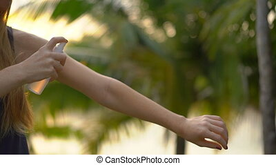 Superslowmotion shot of a beautiful young woman applying an...